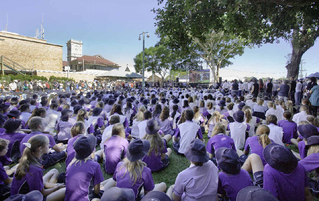PROUD PART OF THE SERVICE: Hundreds of Aldridge State High School students watch the Anzac Day ceremony in Queens Park on the big screen.