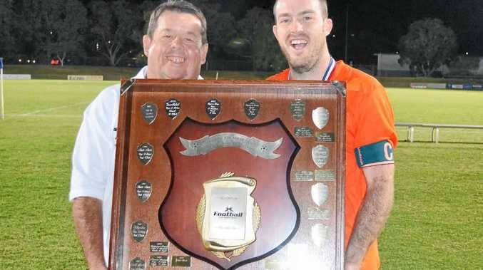 CHAMPION EFFORT: Lennox Head Sharks captain Joel Rudgley, right, accepts the Anzac Cup trophy from Greg McMahon.