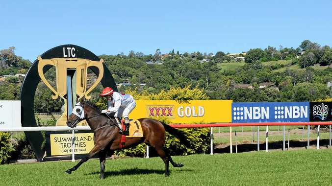 EASY DOES IT: Jockey Jeff Lloyd rides four-year-old gelding Mestalla to an easy win in the Class 2 plate (1516m) at Lismore yesterday.