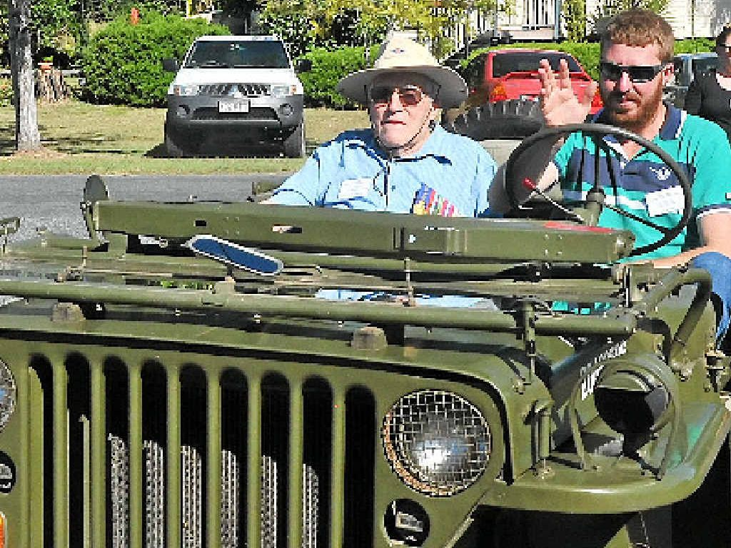 MARCH: Emra Burkit Marxsen rides in an army Jeep in the Ubobo Anzac Day Service March.