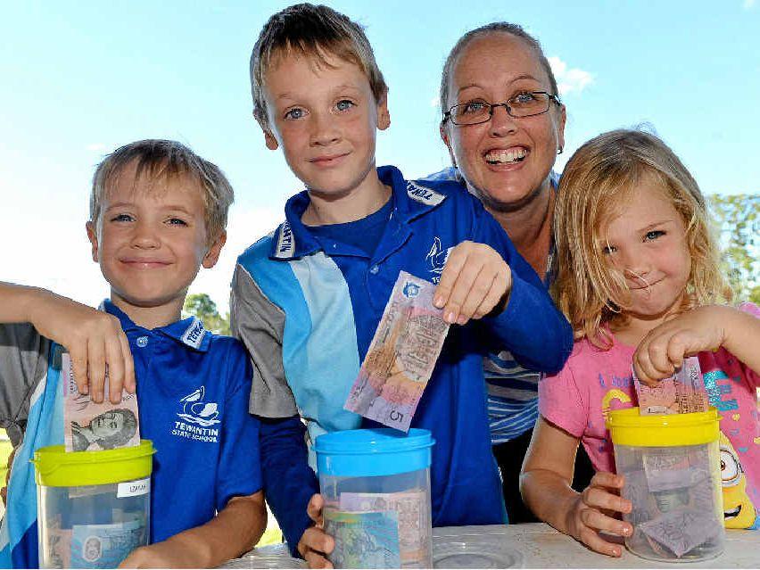 IN THE MONEY: Katie Young's three children, Brayden, 7, Izayah, 6 and Sienna, 4, get $5 each if they do their jobs.