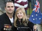 REMEMBERING THE FALLEN: Dale Moore proudly wears his great-grandfather's medals from the Second World War at the Anzac Day dawn service with daughter Sophie Moore.