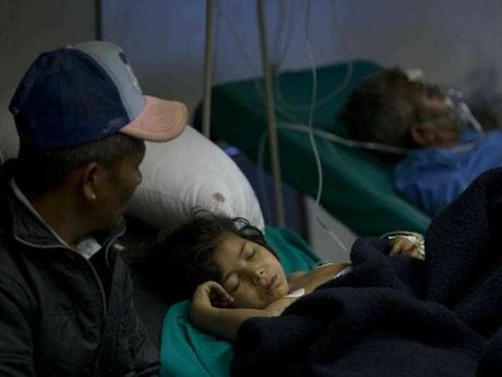 A young Nepalese girl injured in earthquake lies at a hospital ,in Kathmandu, Nepal, Sunday, April 26, 2015. A strong magnitude 7.8 earthquake shook Nepal's capital and the densely populated Kathmandu Valley before noon Saturday, causing extensive damage with toppled walls and collapsed buildings, officials said.