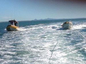 Coast Guard tows back swamped boat