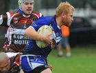 Adam Slater charging in rugby league action between Grafton (blue) and Sawtell at Frank McGuren Oval. Photo: Bruce Thomas / Daily Examiner April 19, 2015