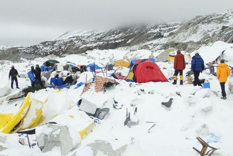 epa04721476 Dozens of tents lie damaged after an avalanche plowed through Mount Everest base camp killing at least 18 people following the 7.9 magnitude earthquake in Nepal, 25 April 2015 (picture made available 26 April 2015). The avalanche that swept through parts of base camp is reported having had the combined force of two separate snowslides from different peaks. EPA/AZIM AFIF Courtesy of Azim Afif