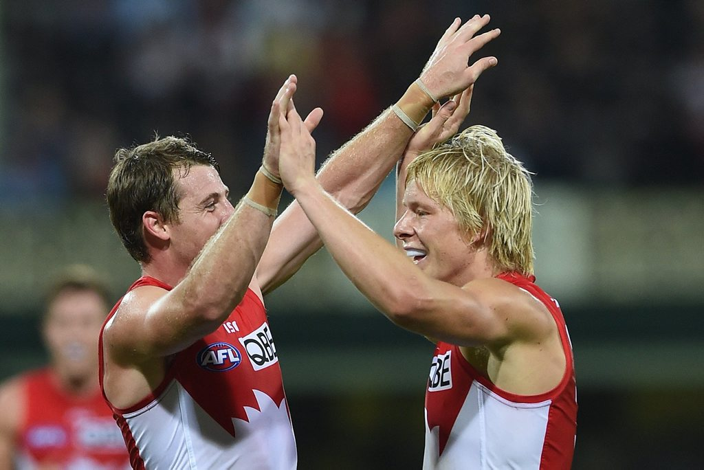 Isaac Heeney (right) of the Swans is congratulated by Harry Cunningham kicking a goal against the Giants during the Round 3 AFL match between the Sydney Swans and the Greater Western Sydney Giants at the SCG in Sydney, Saturday, April 18, 2015. (AAP Image/Paul Miller) NO ARCHIVING, EDITORIAL USE ONLY