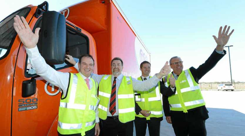 JOBS BOOST: Mayor Paul Pisasale, Cr Paul Tully, TNT northern region director Peter Gutsche and director of networks Curtis Berry launched TNT's Redbank Motorway Estate facility last June.