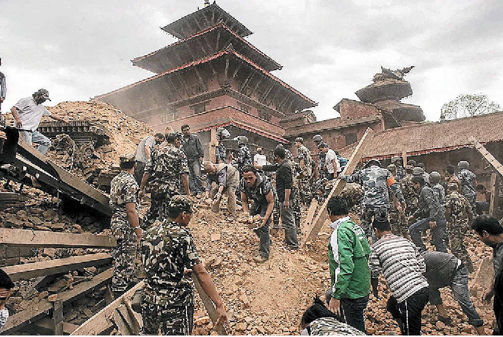 Rescue workers sifting through the ruins of a building, looking for survivors, after a devastating 7.8 magnitude earthquake shook Nepal on Saturday.