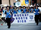 Drum Major Natasha Rees leads the Mackay North State High School Marching Band in Brisbane's Anzac Day parade.