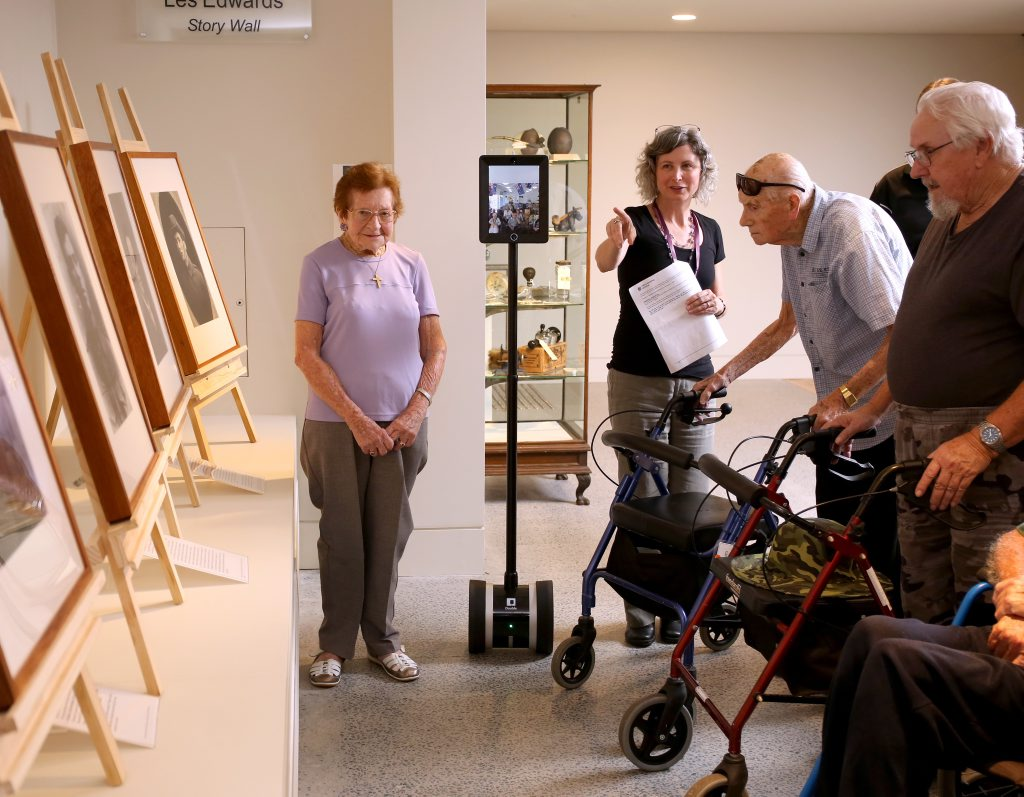 Kirsty Andrews guiding residents of Feros Village Wommin bay along with a robot which provides a virtual tour for residents that cannot physically attend through the Tweed Regional Museum in Murwillumbah. Photo: Nolan Verheij-Full / Tweed Daily News