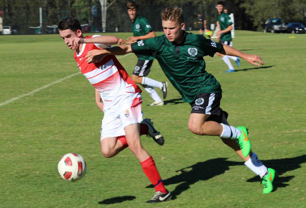 Ipswich Grammar School midfielder Matthew Parkes soaks up the pressure from a BBC defender during their GPS season opener.
