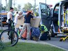 A man on a bicycle was hit by a car on Brisbane Street in West Ipswich on Tuesday afternoon.