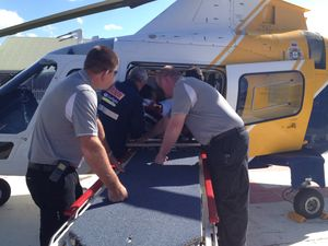 Tourist airlifted after being pinned by a vehicle