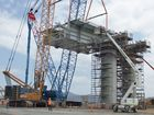 OCTOBER 2013: The first of the stacker gantries is lifted into place at the WICET coal stockyard.