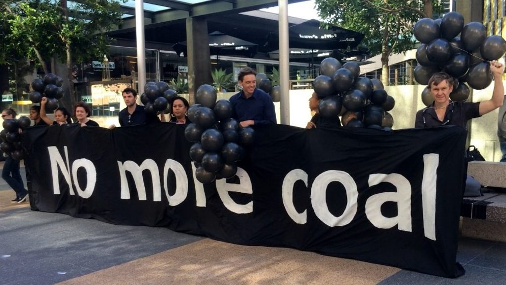 Protesters armed with black balloons stood outside a Brisbane Court Case to show their support for a court case against mining company Adani. Coast and Country are fighting Adani in the Queensland Land Court over the proposed Carmichael Mine and the effects of the mine on climate change is one of the arguments. * Photo Pamela Frost