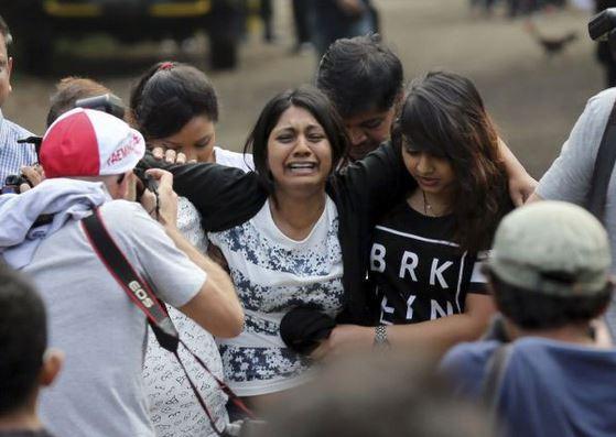 Brintha Sukumaran, the sister of Myuran Sukumaran, cries during her final visit to see him in prison on 28 April