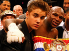 Justin Bieber will carry Mayweather's belt into the ring