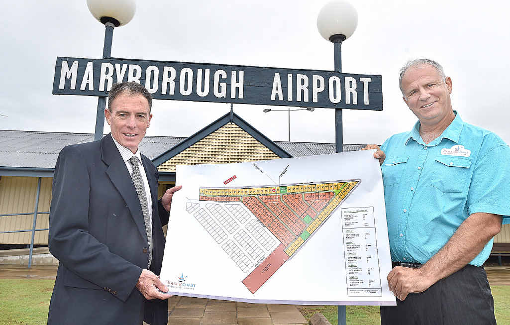 BIG PLANS: Fraser Coast Residential Airpark Pty Ltd director Brad Tallis (right) with Mayor Gerard O'Connell and plans for the proposed development.