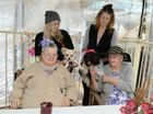 HOLY MUTTRIMONY: John Cani Aged Care Centre residents Valerie Judas and Mary Hubner, with Jaelylen Hurst and Jessica Ellis, congratulate newlyweds Mr and Mrs Anderson after their wedding ceremony.
