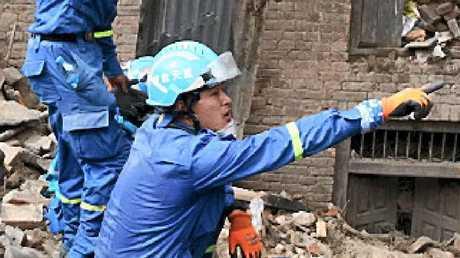 Workers sift through rubble in Bhaktapur, near Kathmandu.