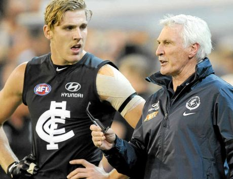 BELL TOLLS: Tom Bell at Carlton training and (inset) with senior coach Mick Malthouse.