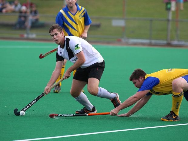 Nortern Stars Matt Hurmon evading an east Lismore defender during the Northern Star v East Lismore hockey match at Goonellabah Sports Club on Saturday, May 2, 2015. Photo: Nolan Verheij-Full / Northern Star