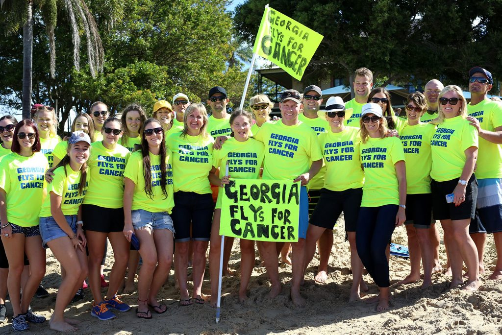 Georgia Quin with her supporters, Georgia swam at Shaws Bay to raise money for Cancer. Photo: Nolan Verheij-Full / Northern Star