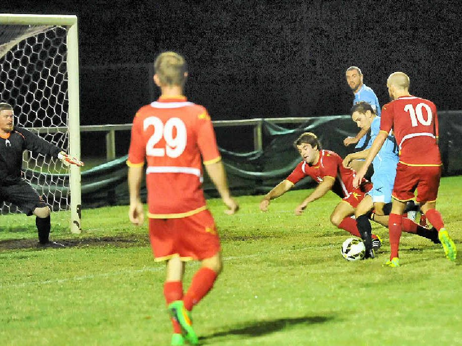 THREAT: Maroochydore's Nick Scarff looks to get a shot away in traffic against NYU in Saturday night's McDonald's Premier League clash.