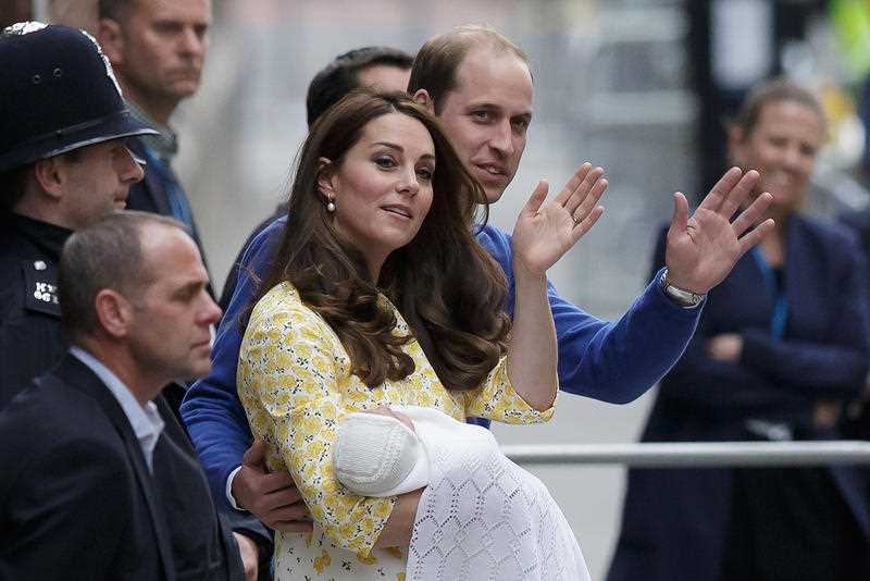 Britain's Prince William and Kate, Duchess of Cambridge and their newborn baby princess, wave to the public as they leave St. Mary's Hospital's exclusive Lindo Wing in London, Saturday, May 2, 2015. The Duchess gave birth to the Princess on Saturday morning.