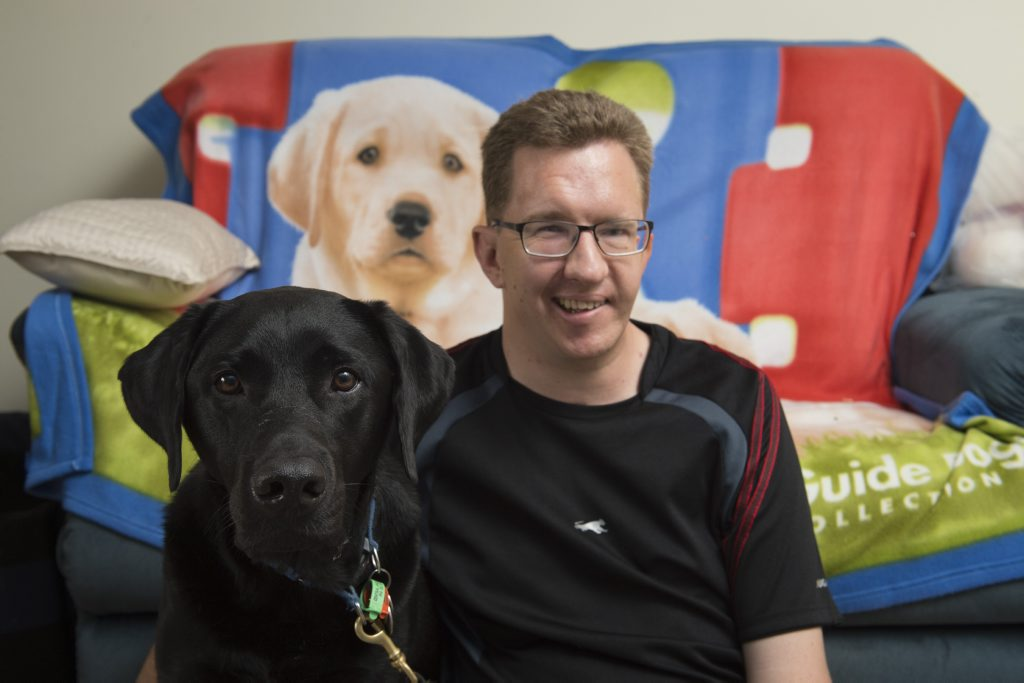 John Gamble and his guide dog Cole.