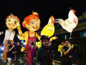 Festival parade lights up city