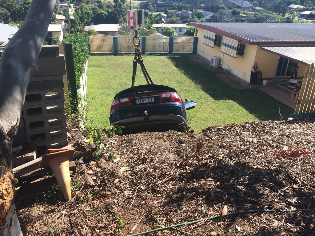 The car that had to be lifted out of a neighbours backyard after a man died in it while trying to park.