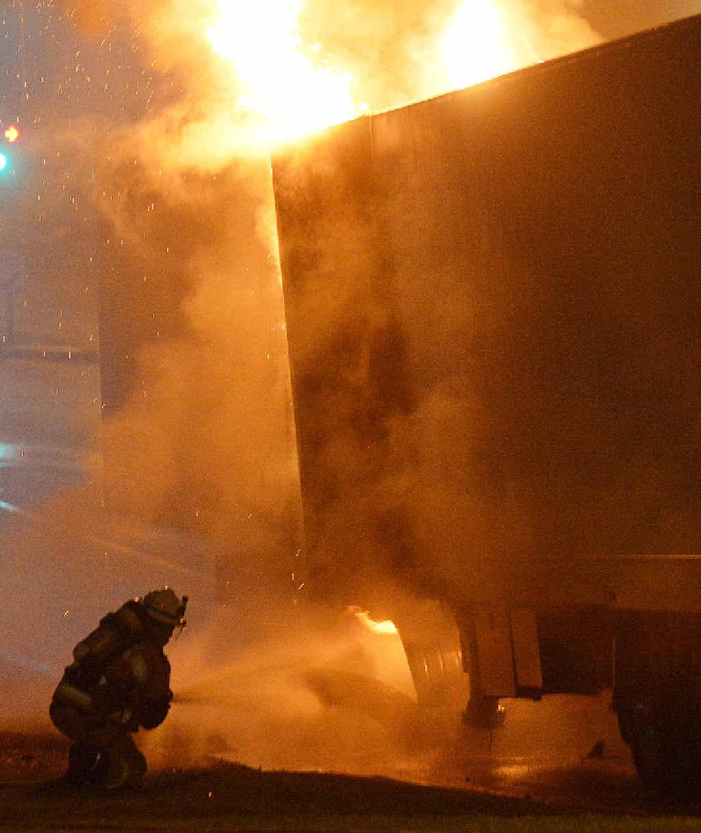 EMERGENCY: Firefighters battle the blaze.
