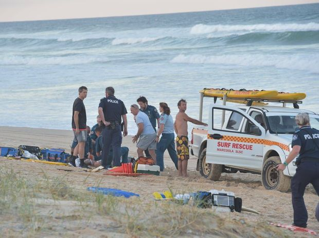Paramedics perform CPR on a man who was pulled from the surf unconscious at Marcoola Beach. He was pronounced dead on the scene. Photo: Brett Wortman / Sunshine Coast Daily