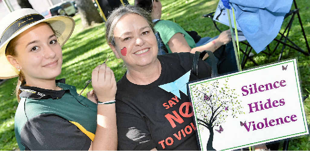 NO TO VIOLENCE: Jessica Dwight and Theresa Justin were two of many who walked for peace at home in Mary St yesterday.