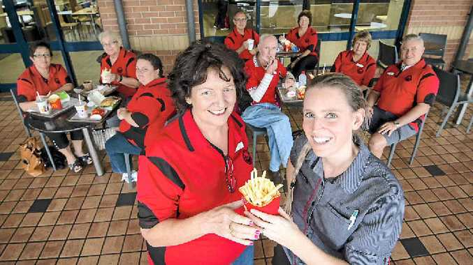 REWARD FOR EFFORT: Volunteers from the Gladstone Aquatic Therapy Association enjoy a special treat for all their hard work, with coordinator Leanne Stocker (front left) and Kin Kora McDonald's manager Jane Croser.