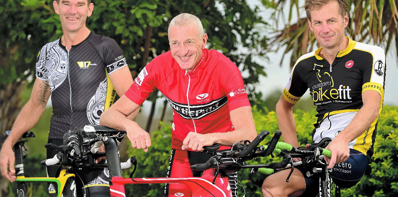SOME SAY THEY'RE NUTS: (left to right) Robbie Andrews, Tony Bryan and Steve Gage take a break from training for the Ultraman Australia Challenge.