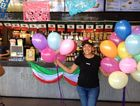 Celeste Matos celebrates $5 burrito day at Guzman Y Gomez at Stockland Gladstone.