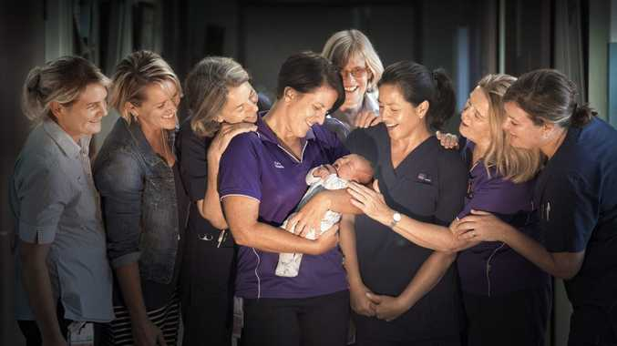 Grafton Base Hospital midwives Lee O'Shea, Laurel Moore, Susan Bewey, Katie Dobbin, Angie Garland, Sandy McCarthy, Marg Craemri and Bettina Almonda try to get a look at new arrival Michael Gudz, born on May 4. Photo Adam Hourigan / The Daily Examiner