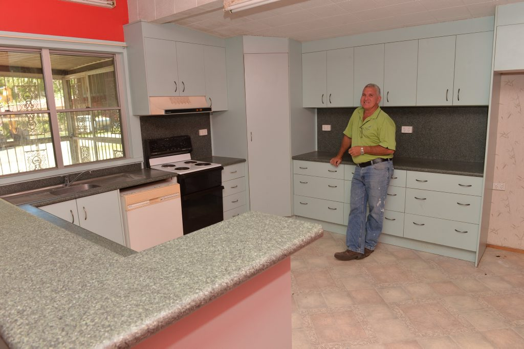 Stephen Challen inside the 'Give away house' at Andergrove.