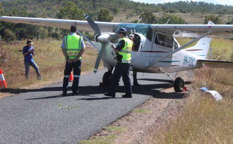 Emergency crews wait for engineer to arrive at emergency landing site.