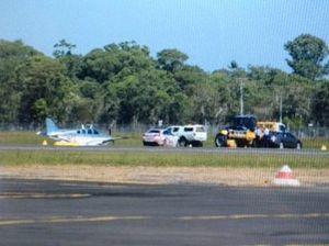 Light plane crash lands at airport