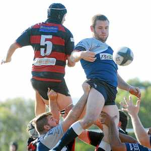 UP THERE: Mat Quirk and Morgan McDonogh soar high for the ball in the last Coffs local derby.