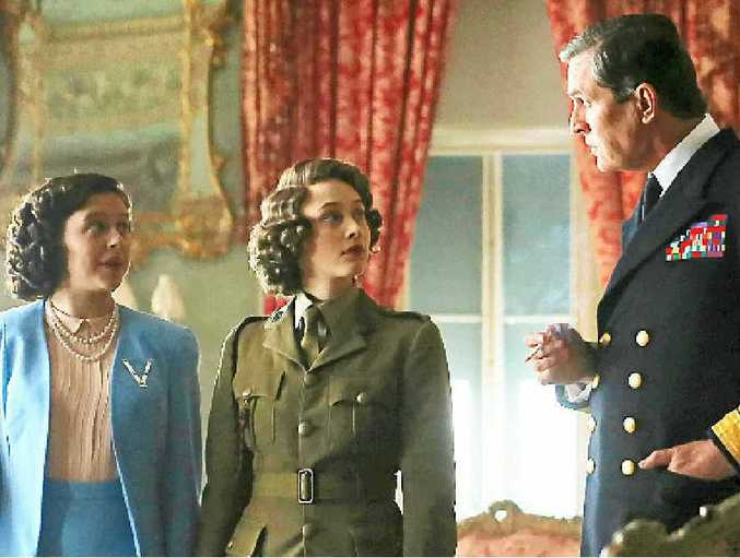 Bel Powley, left, Sarah Gadon and Rupert Everett in a scene from the movie A Royal Night Out.