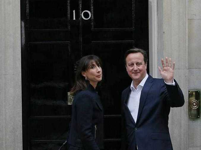 British Prime Minister and Leader of the Conservative Party David Cameron (R) and his wife Samantha are pictured as they arrive at 10 Downing Street in London on May 8, 2015, the day after a general election.