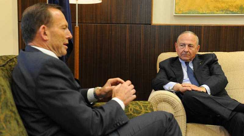 Prime Minister Tony Abbot (left) speaks with Maurice Newman, AC at the governemnt's offices in Treasury Place in Melbourne, Thursday, Sept. 26, 2013. Newman will be in charge of the government's business advisory council.