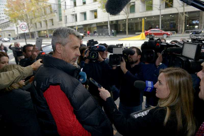 Vehid Cauesvic (left), the father of Harun Causevic, one of two teenagers accused of conspiracy to commit a terrorist act, is met by the media outside the Melbourne Magistrates Court after his son's bail application was refused in Melbourne, Friday, May 8, 2015.