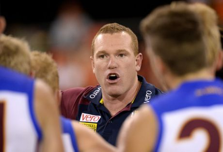 GOLD COAST, QUEENSLAND - MAY 02: Coach Justin Leppitsch of the Lions talks to his players at the third quarter time break during the round five AFL match between the Gold Coast Suns and the Brisbane Lions at Metricon Stadium on May 2, 2015 in Gold Coast, Australia. (Photo by Bradley Kanaris/AFL Media/2015 AFL Media)