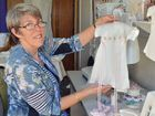 SPECIAL VOLUNTEER: Gail Larsen volunteers with the Angel Gown Program, making gowns for stillborn babies from donated wedding gowns.